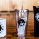 Cedar Grove Coffee House coffee mug, plastic tumbler, and coffee thermos