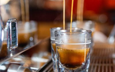 Espresso being poured into a shot glass
